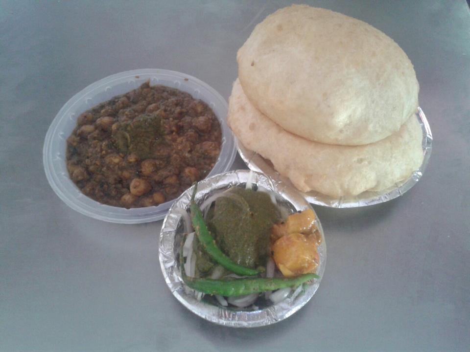 chole bhature with green chillies at CL Corner